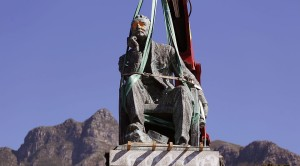 A crane prepares to remove the statue of British colonialist Cecil John Rhodes at the Cape Town University in Cape Town, South Africa, Thursday, April 9, 2015. The University of Cape Town will today remove the statue of British colonialist Cecil John Rhodes after weeks of protest by South African students, who said the statue had become a symbol of the slow racial transformation on campus. (AP Photo/Schalk van Zuydam)